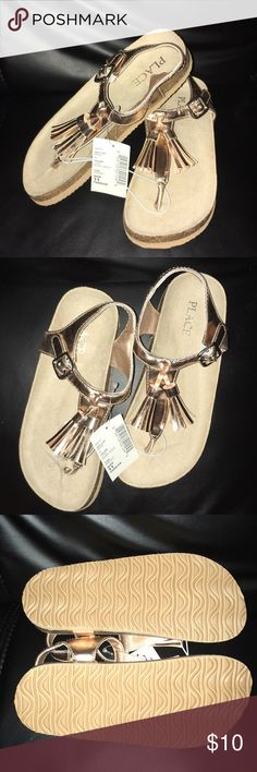 Girls Toddler size 11 Gold Tassel Sandals  NWT Brand: The Children's Place Size: Toddler 11 Condition: NWT All man made materials  Perfect for upcoming Spring and Summer warm weather. Shiny gold for a little bit of glam. Perfect pair to dress up any outfit!   **Bundle and Save** The Children's Place Shoes Sandals & Flip Flops