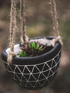 Hanging planters - I could try making my own. (1) Ceramic drill bit (2) Rope/Twine (3) Plant pot of choice.