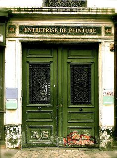 """Apocalypse ……A doorway on the Rue St. Antoine………I HAVE OFTEN WONDERED WHY DOORS GET SO """"BEAT UP"""" NEAR THE BOTTOM ??…..IS IT BECAUSE PEOPLE KICK THEM TO OPEN ??………..ccp"""