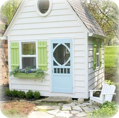 tiny house in white with blue & green accents
