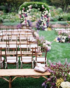 """Pinterest Board: Ceremony IdeasClusters of """"planted"""" garden flowers adorned this aisle, and ceremony seating was a mix of Chiavari chairs and wooden benches."""