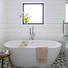 Currently wishing we were soaking the day away in this gorgeous tub. #homedecor #goals  (Photo by Trevor Tondro design by Daleet Spector) by housebeautiful