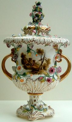 Rockingham Campana-shaped pot-pourri vase. Puce griffin marked, cl.3 in gilt, c.1830-42, Height 34cm Flower encrusted, painted with a landscape, the reverse with flowers and fruit.