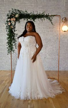 he sweetheart neckline and bodice are masterfully designed to provide ultimate support and fit for all-day comfort. This plus-size wedding dress is covered in timeless floral and lace-inspired patterns for a truly classic look. The back of the bodice has sheer details with a lovely lace overlay, showing off the stunning intricacies of the floral lace pattern. Lace motifs cascade down the skirt of the gown for a romantic look, with layers and layers of soft tulle creating a frothy, flowing skirt. Affordable Wedding Dresses, Sexy Wedding Dresses, Bridal Dresses, Lace Wedding, Blush Bridal, Allure Bridal, Stella York Bridal, Essense Of Australia, Designer Bridesmaid Dresses