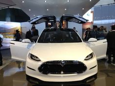 Foster... 2014 Tesla Model X  The gull wing doors on the Tesla Model x captures the imagination of families looking for an electric crossover.
