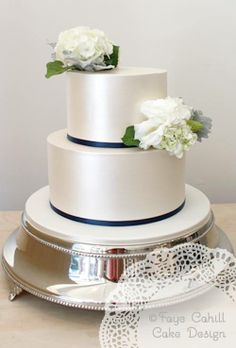 Lustre finish and fresh flowers cake by Faye Cahill Cake design
