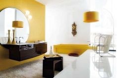 Perfect Bathroom Inspirations With Modern Furniture Set : Chic Yellow Bathroom Interior Design With Large Round Mirror On Yellow Paint Wall And Dark Wooden Vanity Along With Yellow Bathtub Plus Lamp Sttand On Floor