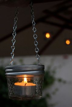 DIY Hanging Candle Holder | Fun and Cute Mini Mason Jar Crafts | Creative Home Decor Ideas, Wedding Favors, Makeup Organizers & more! by DIY Ready at http://diyready.com/23-diy-crafts-with-mini-mason-jars/