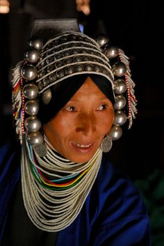 Portrait by Jerry Redfernof a Shan State, Myanmar  Hill Tribe  woman wearing traditional headress