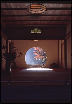 Japanese styled room with round window, framing a tree, photo by...?
