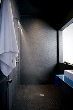 hexagon stone mosaic tiled bathroom