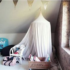 What an adorable children 's room at @mode_en_france with our woodlands wallpaper in the background and @numero74_official 's canopy. Match made in heaven.  Tutorial on how to make a rolling bookcase on @mode_en_france's blog.  #childrensroom #childrenswallpaper #pink #kidswallpaper