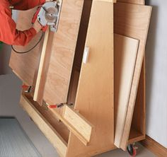 """Turn a single sheet of plywood and a few pieces of hardware into a portable workbench that """"knocks down"""" for compact storage. Lumber Storage, Storage Cart, Wood Storage, Workshop Organization, Storage Organization, Workshop Ideas, Easy Projects, Wood Projects, Wood Bin"""
