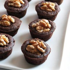 Zucchini makes these treats nice and moist. You can substitute pecans for the walnuts.