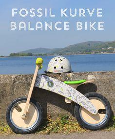 Dinosaur Kurve wooden balance bike with matching helmet! Great for those summer rides...