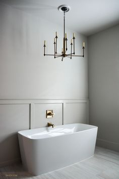 French Rustic Cottage by Two Thirty Five Designs Free Standing Tub with Gold Plumbing and Chandelier