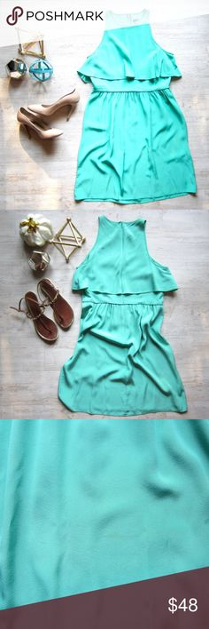"""🎉HP🎉 Silk TIBI Layered Dress 👗 This fun, layered dress by TIBI New York is featured in the prettiest mint green color. Gorgeous 100% silk. Has a hidden zipper half way down the back of the dress and piping along the waist. Lightweight.  There are a few light markings located on the bottom front of the dress. Tried my best to capture a good photo, 3rd pic.    Length is 37.5"""" and 18.5"""" across the chest. Tibi Dresses"""