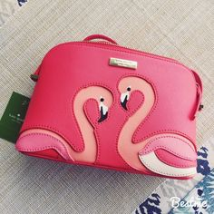 kate spade flamingo crossbody bag, BNWT!  kate spade flamingo crossbody bag, BNWT!  This item is unused and brand new! Bag has attached crossbody strap. Beautiful pink colors with flamingos on the front. Perfect for summer! Bundle and save! No trades or PayPal!  kate spade Bags Crossbody Bags