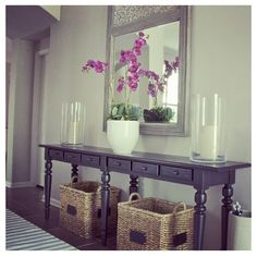 Baskets under foyer table/table cut in half for foyer