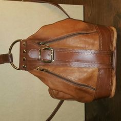 """Valentino backpack.....vintage Valentino di Paolo Leather Backpack / Purse  Color: brown Material: leather?? Style:fashion Size: medium? Measurements:? 9"""" length, 8"""" width, 14"""" depth, 22"""" drop Special Instructions/Notes: made in Italy Valentino Bags Backpacks"""