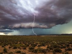 A thunderbolt spears the plateau during a summer storm in Vermilion Cliffs National Monument in this National Geographic Photo of the Day.