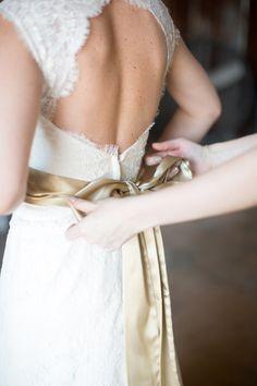 Paloma Blanca gown + champagne sash.