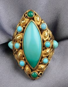 14kt Gold and Turquoise Ring, the navette shaped ring, set with cabochon green and blue turquoise