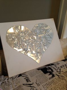 Broken mirror art! Supplies needed: mirror , hot glue gun and hot glue, canvas, hammer and sheet ( sheet will help contain the broken glass)