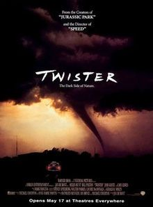 "Divorced stormchasers (Helen Hunt, Bill Paxton) get together when he wants to marry someone else (Jami Gertz) and CAN'T STOP TO TALK THERE'S A TORNADO TO TRACK! A device nicknamed ""Dorothy"" has to be dropped in the eye of the storm so all can see the face of the disaster. Directed by Jan de Bont (""Speed"")."