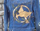 My next DIY: The Hunger Games demin jacket picturing the Mocking Jay.. via Etsy.