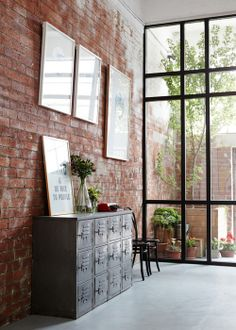 large windows + exposed brick for office space