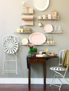 Small space dining  -  cute wall racks