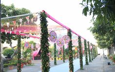 This Vibrant Mehendi Affair in Indore Will Give You Tons of Quirky Decor Ideas! Outdoor Wedding Entrance, Indian Wedding Theme, Quirky Decor, Entrance Decor, Wedding Ceremony Decorations, Wedding Ideas, Wedding Planning Websites, Winter Wonderland Wedding, Event Decor