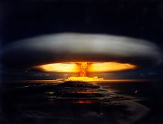 Licorne, a French nuclear weapon, a 914 kiloton thermonuclear shot detonated in 1970 at the Fangataufa atoll in French Polynesia.  This image shows the brief condensation cloud that formed in the first 20 seconds or so exaggerating the width of the actual mushroom cloud