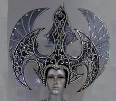 very large headdress with dragon-y wings