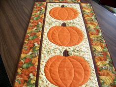 This tablerunner is called Autumn Harvest. The design is by local designer, Tammy Finkler . Can't you just picture this on your table thi. Patchwork Table Runner, Table Runner And Placemats, Table Runner Pattern, Quilted Table Runners, Table Topper Patterns, Quilted Table Toppers, Halloween Quilts, Halloween Sewing, Halloween Wreaths