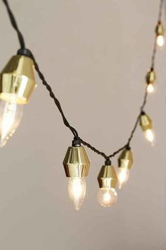 Metal Cap String Lights from Urban Outfitters. Saved to Room. Shop more products from Urban Outfitters on Wanelo.