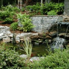 Retaining wall with water fall and small pond.