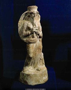 Female musician playing the double flute. Terracotta (4th BCE), from the Punic necropolis of Borj Jdid, Carthago. Phoenician culture  Louvre Museum