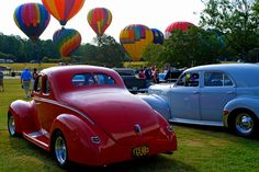 Color is in the Air - Classic Cars and Hot Air Balloons by StGrundy on Flickr.Color is in the Air - Classic Cars and Hot Air Balloons