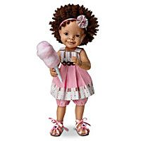 Lifelike little girl doll by Jane Bradbury, handcrafted, hand-painted, and poseable, with pink-and-brown pleated sundress and cotton candy accessory.