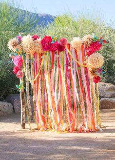 11 Ideas That Will Transform Your Backyard Into The Best Wedding Ever - Gorgeous garlands and hand made pom poms for the arbor