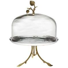 Glass cake stand with brass leaf-shaped accents. Product: Cake stand and dome Construction Material: Stainless steel, glass and brass Color: Gold and silver Features: Leaf-shaped accents Dimensions: H x Diameter Cleaning and Care: Hand wash Cake Stand With Dome, Cake Dome, Cupcake Stands, Vase Deco, Cake Pedestal, Dessert Aux Fruits, Fruit Plate, Plate Design, Deco Design