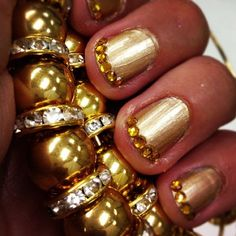 Gold with gold stones on super short nails.  Love it, but I would never have natural nails!