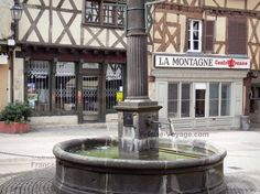 Ambert: Fountain and houses with wood sides in the old town; in the Livradois-Forez Regional Nature Park - France-Voyage.com #auvergne