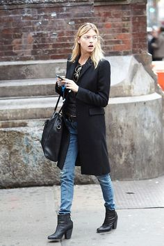 long tailored coat over jeans  with belt and leather givenchy bag