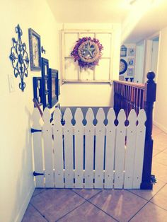 I had a vision of a Non Plastic, Non Tacky baby gate for our stairs.  I told my husband what I wanted and he whipped up this awesome gate.  I love that it is permanent and darling.  -Carly Homer
