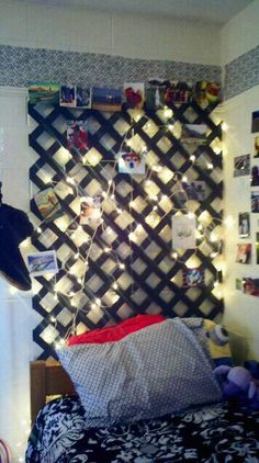 Lattice painted black with white christmas lights. makes an amazing headboard for a college dorm room. Dad and I did this ourselves!!!