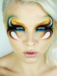Crystal accented artistic and extremely colorful fantasy eye make-up by Ida Aztor.