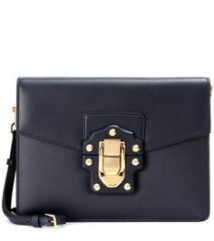 Dolce & Gabbana - Lucia leather shoulder bag - The Lucia shoulder bag from Dolce & Gabbana is a supremely luxurious design, crafted from smooth dark blue leather. The compact style comes with a logo-engraved golden snap lock and studded details. The chic interior, lined with pretty rosy beige leather, will fit all your essentials. This versatile piece also has a detachable shoulder strap in matching dark blue. seen @ www.mytheresa.com